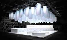 The aim in creating the concept of this stand at the 2015 interzum trade fair was to present an extended collection of speciality papers by manufacturer Munksjö. In order to visualise this, the design focused on light staging. Exhibition Stall, Exhibition Stand Design, Temporary Architecture, Interior Architecture, Standing Signage, Exibition Design, Expo Stand, Trade Show Design, Sign Board Design