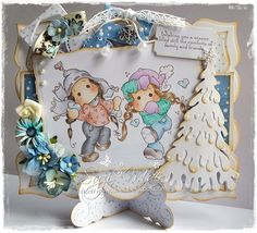 Easel stand Christmas card using stamps from Magnolia Winter Wonderland 2013 collection from http://www.magnoliastamps.us/  #cards #crafts. More info at http://wwwsuzies.blogspot.co.uk