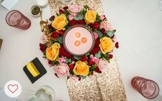 Wedding floral centrepiece with large pink candle