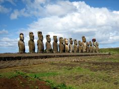 AhuTongariki - Statue / Moai of Easter Island facing inland, Ahu Tongariki, c. 1250 - 1500, restored by Chilean archaeologist Claudio Cristino in the 1990s Photo taken by Ian Sewell, July, 2006. Ahu Tongariki on Easter Island. These moai were restored in the 1990's by a Japanese research team after a cyclone knocked them over in the 1960's.
