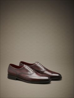 Hand-dyed calfskin lace-ups with fine perforations, Soft Goodyear construction. #fw14 #man #accessories