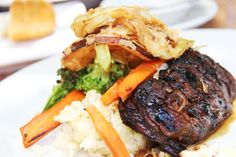 Marinated grilled teriyaki skirt steak with garlic mashed potatoes, house made onion rings, and seasonal vegetables