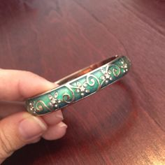 """Retired Brighton Mystique Teal Bracelet Beautiful retired teal floral bracelet with Swarovski crystals by Brighton. Magnetic hinged snap closure. Silver plated, enamel. Great condition. Width: 1/2"""" Diameter: 2 3/4"""" Brighton Jewelry Bracelets"""
