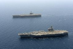 The aircraft carrier USS George H. W. Bush, bottom, transits alongside the aircraft carrier USS Harry S. Truman in the Gulf of Aden. George H.W. Bush is taking over support of maritime security operations and theater security cooperation efforts in the U.S. 5th Fleet area of responsibility. JAMIE COSBY/U.S. NAVY