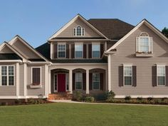 This+eye-catching+traditional+exterior+is+rooted+into+its+landscape+with+an+earthy+palette+of+taupe,+beige,+brown+and+red.+Choose+muted+hues+for+a+warm,+sun-baked+look.+Paint+colors:Tavern+Taupe,+Pavillion+Beige,+Homestead+Brown+and+Rustic+Red+by+Sherwin-Williams