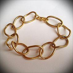 Gold bracelet by Silva Sitara
