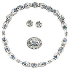 Sterling Silver and Moonstone Necklace/Bracelet, Pair of Earrings and Brooch, Georg Jensen   Signed Georg Jensen, GI 138, GI 64, Denmark, c. 1910 & 1915, ap. 55.4 dwt. Length 23 inches.