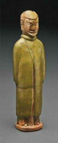 A large olive-glazed red pottery figure of a foreign soldier, China, Sui dynasty (AD 581-618)