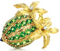 Jean Schlumberger's cocoa bean clip (circa 1965) for Tiffany & Co. features bright tsavorites and diamonds set in 18-karat gold and platinum.