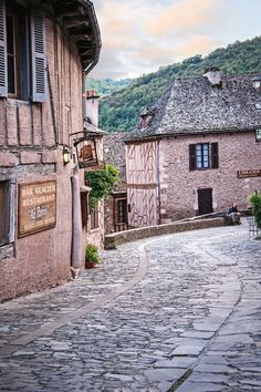 A cobbled street in Conques, Aveyron, France. Photo: Michael Paul #village