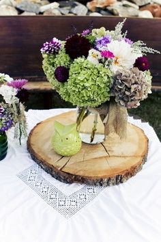 Use a thin slab of wood to instantly make a vase of flowers look more special: | 21 Centerpieces You Can Easily DIY