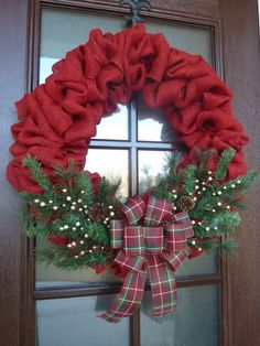 This beautiful red burlap wreath has the perfect mix of traditional and warm, country Christmas feel to it! It is decorated with greenery, pine cones, cream and light gold berries, and a lovely handma Dollar Store Christmas, Christmas Bows, Christmas Projects, Handmade Christmas, Christmas Ornaments, Christmas Ideas, Christmas 2019, Christmas Pageant, Elegant Christmas