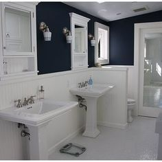 Thinking about redoing the bathroom w/navy blue like this....hmmm