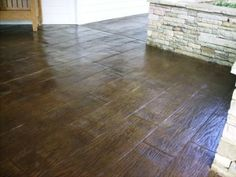 Stamped concrete that looks like hardwood.