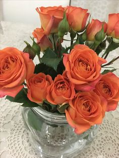 Dark peach Bunch roses in a mason jar for the dining table