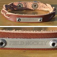 Field Hockey Plated Leather Bracelet Field Hockey - This genuine leather field hockey bracelet features a personalized engraved plate and a dual snap closure to adjust to different wrist sizes.