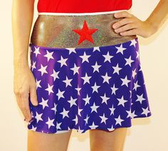"""SwingStyle Woman of Steel Based on the feminine super-hero, this lightweight skirt features a gold holographic waistband and red star. Silver wicking anti-ride undershorts and 5X5"""" pockets adorn each leg. 12"""" zippered pocket in the back waistband holds valuables or superhero treats."""