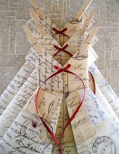 Carte Postale Dress Garland (How to make an origami dress: http://www.howcast.com/videos/510914-How-to-Make-a-Dress-Origami)