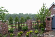 Beautiful Brick And Wood Fence How Does Your Garden Grow