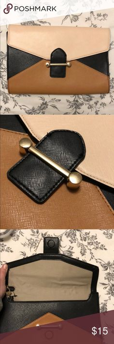 The Limited Large envelope clutch Great condition and super cute, this black, cream and tan bag goes with everything. Can be carried as a clutch or use the wrist strap as a wristlet. The Limited Bags Clutches & Wristlets