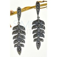 Dancing Leaves Sterling Silver Earrings - each leaf is adorned with handfinished detailing and marcasites creating sparkle and beauty. The face of the post is an elongated pear shaped face that is also adorned with detailing and marcasite. The earrings are artfully handcrafted using .925 sterling silver. http://simplybeautiful2012.com/dancing-leaves-sterling-silver-and-marcasite-earrings.html#