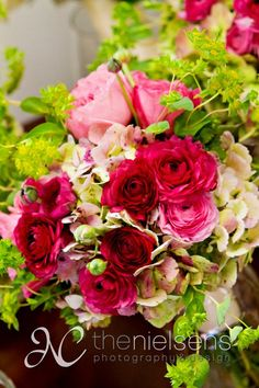 Bridesmaids bouquet with bupleurum, pink garden roses, pink hydrangea, pink ranunculus, and pink spray roses