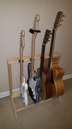 Guitar Stand for Acoustic and Electric - 4 Guitars Guitar Storage, Guitar Rack, Guitar Stand, Cool Guitar, Home Music Rooms, Home Studio Music, House Bugs, Drum Pad, Guitar Tuners