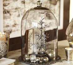 """Alston Mercury Glass Tray & Cloche  Silvered inside and etched with a botanical motif, this tray is covered with a clear cloche, creating a striking display setting for candles and decorative objects.  12.25"""" diameter, 17"""" high  Cloche is crafted of glass over a pressed-glass tray with antique-mercury finish.  $119"""