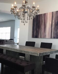 The organic luxury of our Timber Dining Table perfectly complements the impressive glow of our Omni Chandelier in @jessicalynnkb's dining room.
