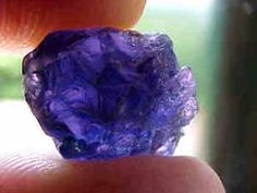 Iolite (cordierite), is usually a purplish blue when cut properly, with a softness to the color that can be quite attractive. The best color is a lovely violet blue that is unlike other gemstones. Pleochroism is very pronounced in iolite and is seen as three different color shades in the same stone. Depending on the viewing angle, iolite will display violet blue, yellow gray or a light blue.  Its hardness of 7-7.5 makes it a suitable jewelry stone.