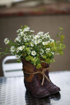 Cowboy boot centerpiece: I like using a pair, the single boots look odd