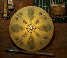 This targe features mixed Celtic and fantasy elements. The boss is hand hammered brass. This Scottish Targe was designed by Mike Pruette at CelticLeatherworks.com.