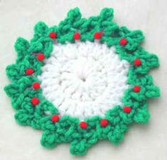 FREE Crochet Pattern - Maggie Weldon - Holly Coaster : Add extra rows to make dishcloth or trivet for Christmas. Christmas Coasters, Crochet Christmas Ornaments, Christmas Crochet Patterns, Holiday Crochet, Crochet Snowflakes, Christmas Crafts, Christmas Yarn, Christmas Items, Christmas Decorations