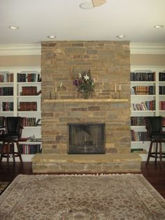 basement fireplace did in 2000 Kasota limstone hearth & mantel frm Minnesota Chilton limestone from Fon Du-Lac Wis. & buff mortar. nice house above this one master bedroom is a see through fireplace lots of stonework outside also....