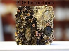 """These instructions are the full version of my freeform peyote/brick stitch bracelet that is featured in the book """"Beading Across America,"""" released March of 2011. The .pdf runs 7 pages and is in full color, no drawings or diagrams."""