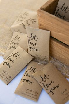 "Wedding favor idea - seeds in brown envelope with ""let love grow"" in black calligraphy {Candace Jeffery Photography}"