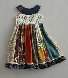 girls field of flowers dress - A rainbow of colors, patterns and textures come together in a delightful dress. The eyelet bodice has a round neckline while polka dot ruffles run around the hem. Field of flowers dress is made in USA. Girl Dress Patterns, Clothing Patterns, Skirt Patterns, Coat Patterns, Blouse Patterns, Little Dresses, Little Girl Dresses, Baby Dresses, Dresses For Girls