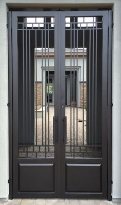VMW is Arizona's leading manufacturer of custom wrought double entry iron gates for homes in Scottsdale, Phoenix and Paradise Valley AZ.