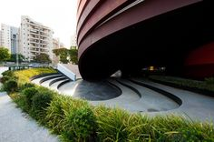 Museum Holon, six ribbons of Cor-Ten steel both support and flow around them, and the circulation routes and outdoor public spaces they encompass http://www.archdaily.com/87173/design-museum-holon-ron-arad-architects/
