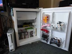 """Transform an old mini fridge into video game storage."""