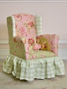 A miniature dollhouse chair in pretty pink and green mixed patterns!