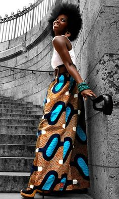African print maxi skirt and blow out afro.