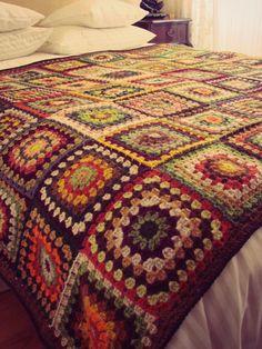 crochet granny square blanket | Snuggling up under my granny square crochet blanket with a book.