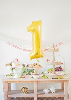 What an amazing first birthday dessert table.