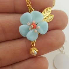 Close up of floral pendant. Created with Czech glass rose petal beads