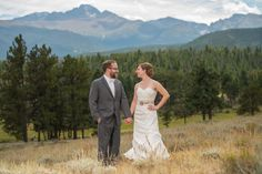 Rocky Mountain National Park Wedding Bride and Groom Holding Hands and Looking at Each Other