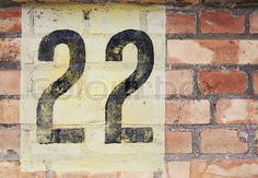house number 22 black on white on red brick weathered