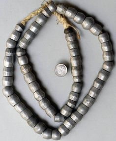Africa | Large Aluminum Beads from Ethiopia | from the early 1900s