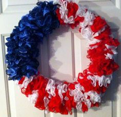 """From fan Donna Kepley on The Crochet Crowd: """"Just wanted to show you what i made from the scarf pattern using Red Heart Sashay that you have on YouTube. there are 2 of the blue (rumba) and 4 of the red/white. wrapped around an 18"""" wire wreath form. Thanks for all the hard work you do to show us new things to make."""""""
