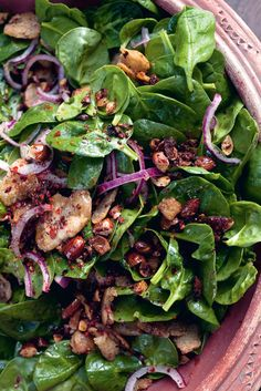 Baby Spinach Salad with Dates and Almonds by Yotam Ottolenghi from the book Jerusalem.